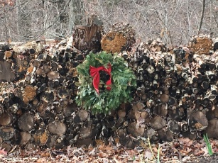 just a pretty wood pile adorned with a wreath
