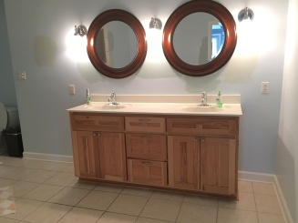 dark wood mirrors with light vanity