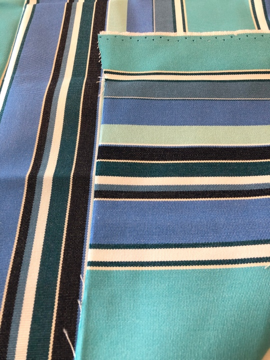 Sunbrella/color and design woven into fabric and shows on both sides